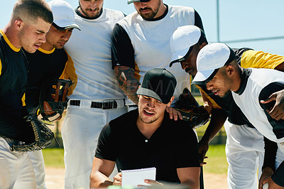 Buy stock photo Cropped shot of a group of young baseball players having a meeting with their coach on the field during the day