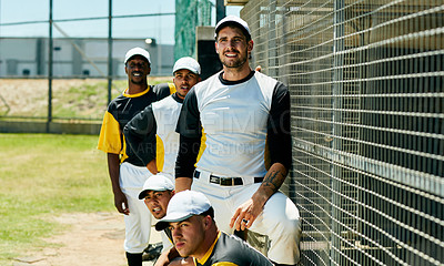 Buy stock photo Cropped shot of a group of young baseball players watching a game near a baseball field during the day