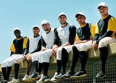 Buy stock photo Cropped portrait of a team of handsome young baseball players sitting near a baseball field