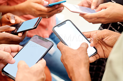 Buy stock photo Closeup shot of a group of unrecognisable people using their cellphones in synchronicity