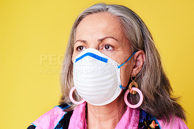 Buy stock photo Cropped shot of a quirky senior woman wearing a N95 face mask against a yellow background