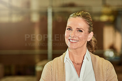 Buy stock photo Cropped portrait of an attractive mature supervisor standing alone in her warehouse during the day