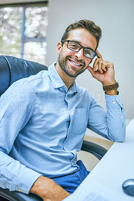 Buy stock photo Portrait of a businessman smiling while sitting at his desk