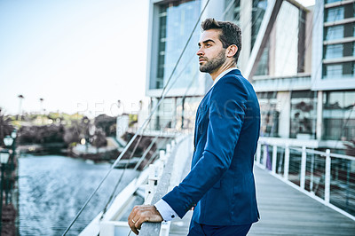 Buy stock photo Cropped shot of a well-dressed businessman out in the city