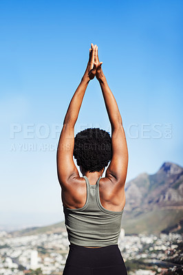 Buy stock photo Rearview shot of an unrecognizable woman practicing yoga while standing outdoors during the day