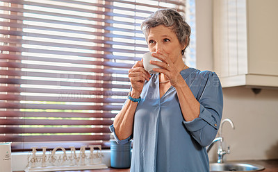 Buy stock photo Cropped shot of an attractive mature woman drinking coffee and relaxing at home
