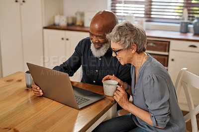 Buy stock photo Cropped shot of an affectionate and happy senior couple using a laptop while relaxing together at home