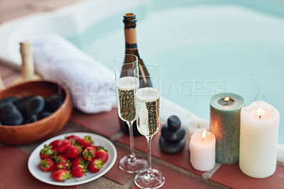 Buy stock photo Cropped shot of strawberries and champagne laid out among candles at a spa during the day