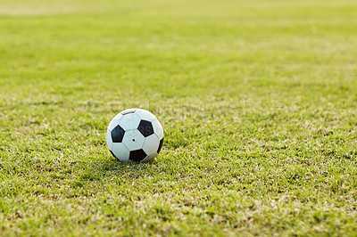 Buy stock photo Still life shot of a soccer ball on an empty sports field