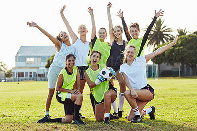 Buy stock photo Full length shot of a team of female soccer players posing together outdoors on the filed