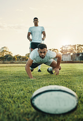 Buy stock photo Full length shot of two young rugby players training with bands on the field during the day