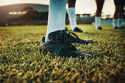 Buy stock photo Cropped shot of an unrecognizable group of rugby players training on the field during the day