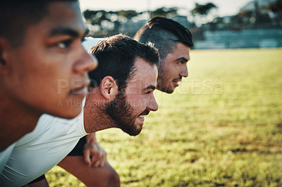 Buy stock photo Cropped shot of a group of three young rugby players lining up for a scrum on the field during the day
