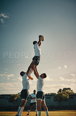 Buy stock photo Cropped shot of a handsome young rugby player catching the ball during a lineout on the field