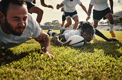 Buy stock photo Cropped shot of a group of handsome young rugby players training together on the field