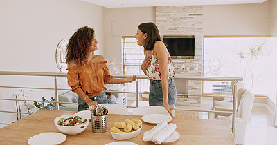Buy stock photo Shot of two young women laying a table in preparation for a lunch party