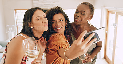 Buy stock photo Shot of a group of young friends taking selfies together during a lunch party at home