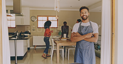 Buy stock photo Portrait of a confident young man hosting a barbecue for his friends