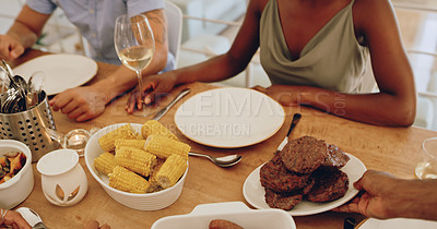 Buy stock photo Cropped shot of a man serving burger patties during a get together with friends at home