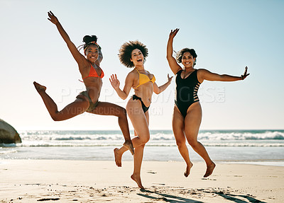 Buy stock photo Full length portrait of a young group of female friends feeling playful during a day out on the beach