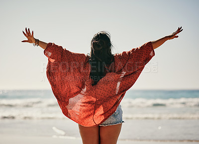 Buy stock photo Shot of a young woman spending the day at the beach in summer