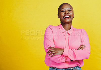 Buy stock photo Portrait of an attractive and confident young woman posing  with her arms folded against a yellow background