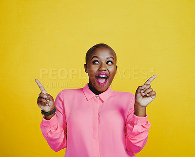 Buy stock photo Cropped shot of an attractive young woman looking cheerful and excited against a yellow background