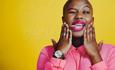 Buy stock photo Cropped shot of an attractive young woman posing with her tongue out against a yellow background