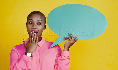 Buy stock photo Portrait of an attractive young woman feeling shocked while  holding up a speech bubble against a yellow background