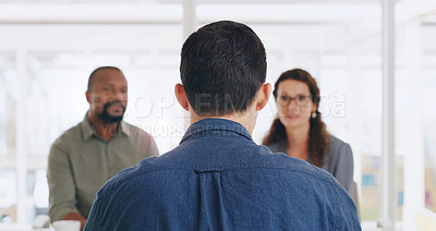 Buy stock photo Rearview shot of a businessman being interviewed by two businesspeople in an office