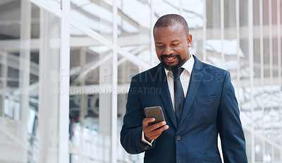 Buy stock photo Shot of a mature businessman using a cellphone in an office