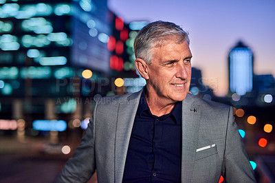Buy stock photo Cropped shot of a mature businessman posing outdoors in the city at night