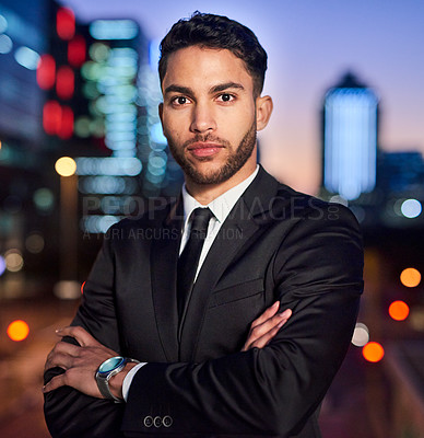 Buy stock photo Portrait of a handsome young businessman posing outdoors in the city at night