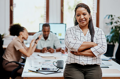 Buy stock photo Portrait of a confident young businesswoman with her team having a meeting in the background