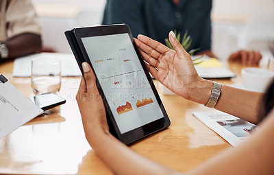 Buy stock photo Closeup shot of an unrecognisable businesswoman analysing graphs on a digital tablet in an office
