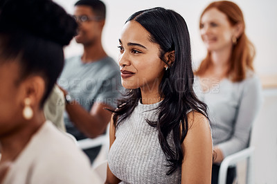 Buy stock photo Shot of a young businesswoman attending a conference