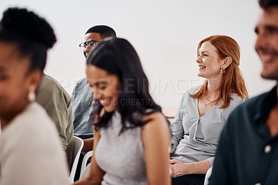 Buy stock photo Shot of a mature businesswoman attending a conference