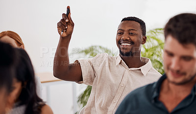 Buy stock photo Shot of a young businessman raising his hand during a conference