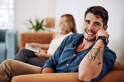 Buy stock photo Cropped portrait of a handsome young businessman sitting with a female colleague in the office
