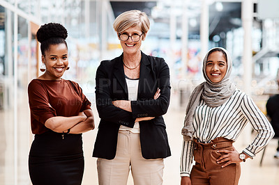 Buy stock photo Portrait of a group of businesswoman standing together in an office