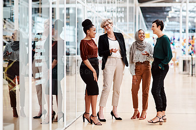 Buy stock photo Shot of a group of businesswomen chatting to each other in an office