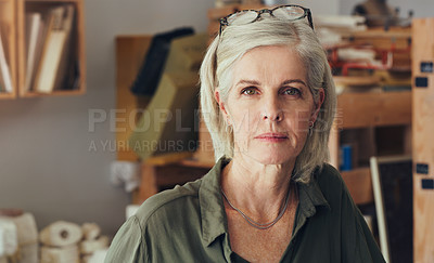 Buy stock photo Portrait of a mature woman working in a pottery studio