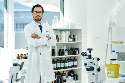 Buy stock photo Portrait of a young scientist standing with his arms crossed in a lab
