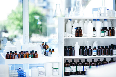 Buy stock photo Shot of bottles of chemicals on shelves in a lab