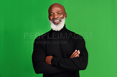Buy stock photo Studio shot of a senior man posing against a green background