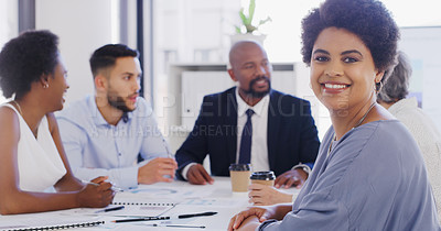Buy stock photo Cropped portrait of an attractive young businesswoman sitting with her colleagues during a meeting in the office