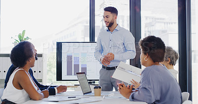 Buy stock photo Cropped shot of a handsome young businessman giving a presentation to his colleagues during a meeting in the office