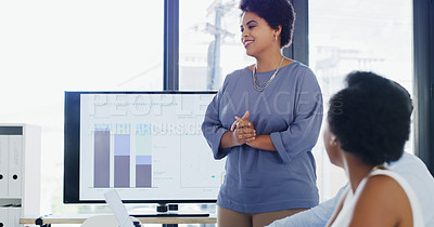 Buy stock photo Cropped shot of an attractive young businesswoman giving a presentation to her colleagues during a meeting in the office