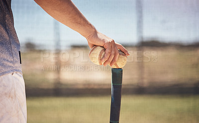 Buy stock photo Cropped shot of a man holding a ball on top of his batting tee at a baseball game