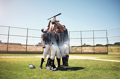 Buy stock photo Shot of a group of young baseball players celebrating after winning a game